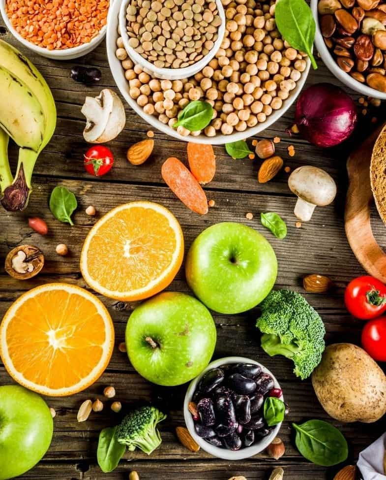fruits, pulses, vegetables on wooden table