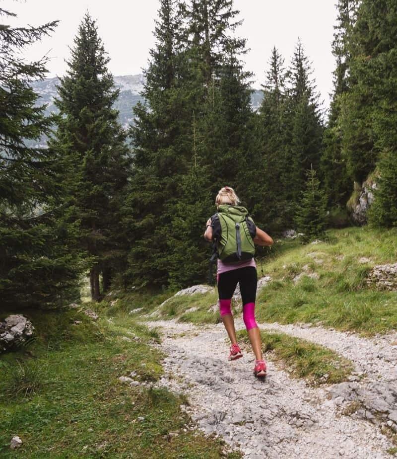 runner on trail wearing backpack