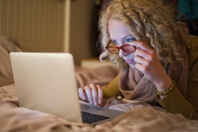 Woman reading off a laptop