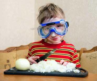 Boy cutting onions