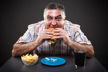 Man eating junk food