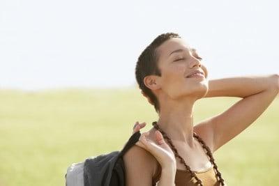 Happy woman in the sun