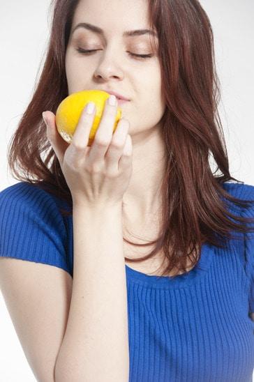 Woman smelling a lemon