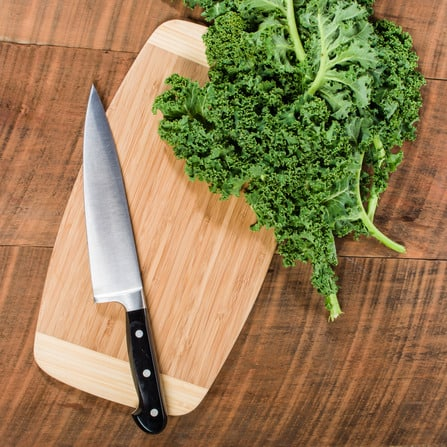 Green curly kale and knife