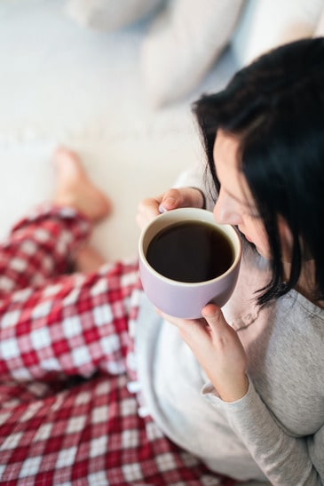 Woman drinking tea from big mug