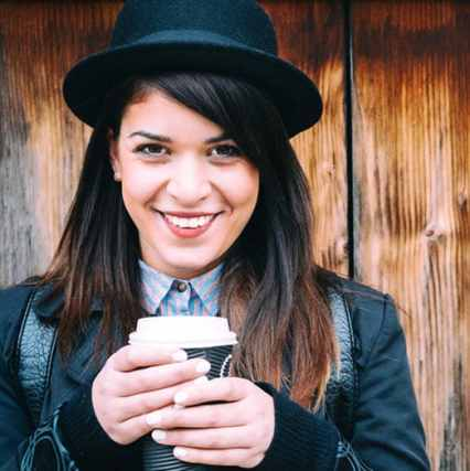 Girl in hat with coffee
