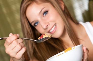 Teenage girl having breakfast