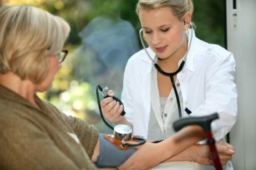 Older woman having blood pressure measured