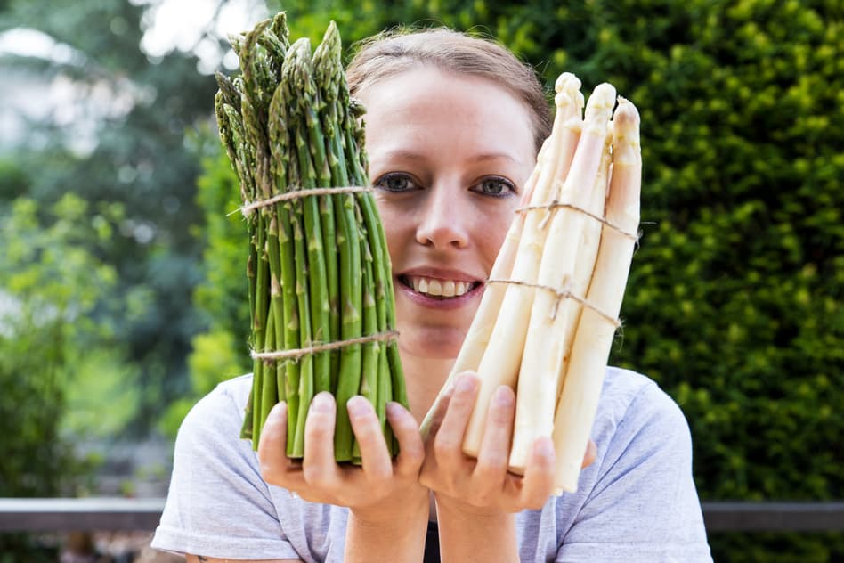 Woman Holding Bunches of Asparagus