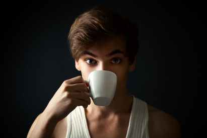 Surprised man drinking coffee