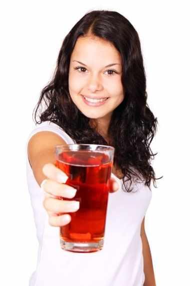 Girl holding cherry juice