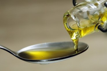 Olive oil on a spoon