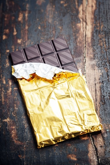 Closeup of  Dark Chocolate on wooden board