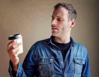 Man staring at coffee