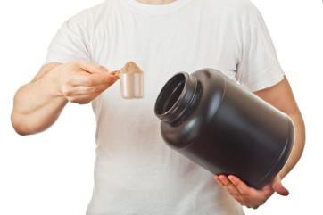 Man with whey protein powder
