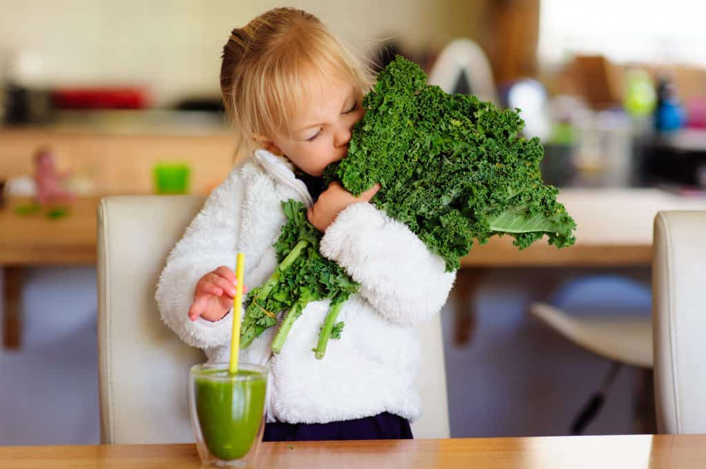 Young girl with kale
