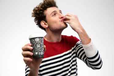 Portrait of a funny man with coffee