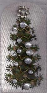 needlepoint christmas tree embellished with scrapbooking brads stitched by needlepoint expert janet m. perry