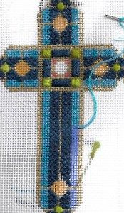 planet earth variegated 6-ply silk thread shown on Lee Needle Arts cross, stitched by needlepoint expert janet m. perry