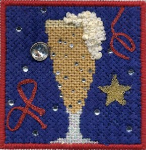 Kathy Schenkel beer glass needlepoint using Kreinik iron-on braid and hot fix crystals along with other embellishments, stitch guide and stitched by neelepoint expert janet m. perrt