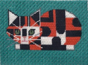 charley harper needlepoint calico cat, stitched by needlepoint expert janet m. perry
