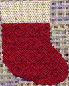 needlepoint mini-sock showing directional light in threads