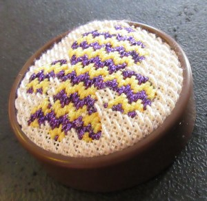 Clover pincushion with needlepoint top,