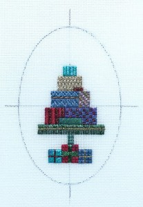 oval needlepoint ornament with design centered