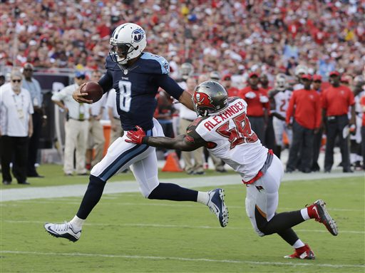 Tennessee Titans quarterback Marcus Mariota (8) runs with the ball as Tampa Bay Buccaneers outside linebacker Kwon Alexander (58) makes the tackle during the first half of an NFL football game, Sunday, Sept. 13, 2015, in Tampa, Fla. (AP Photo/Chris O'Meara)