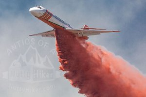 Air Tanker drops fire retardant on a fire at Dana Peak Park.