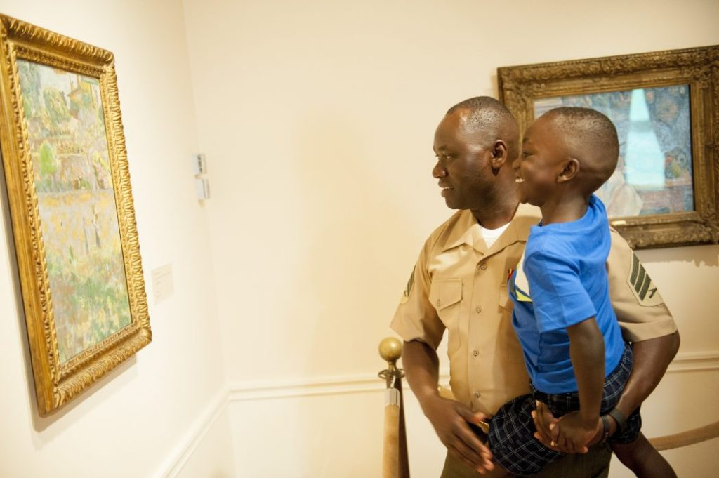 Marine Sgt. Jimmy Ochan and his son William enjoy their visit to the Phillips Collection at the launch event for Blue Star Museums. Photo Courtesy of Blue Star Museums