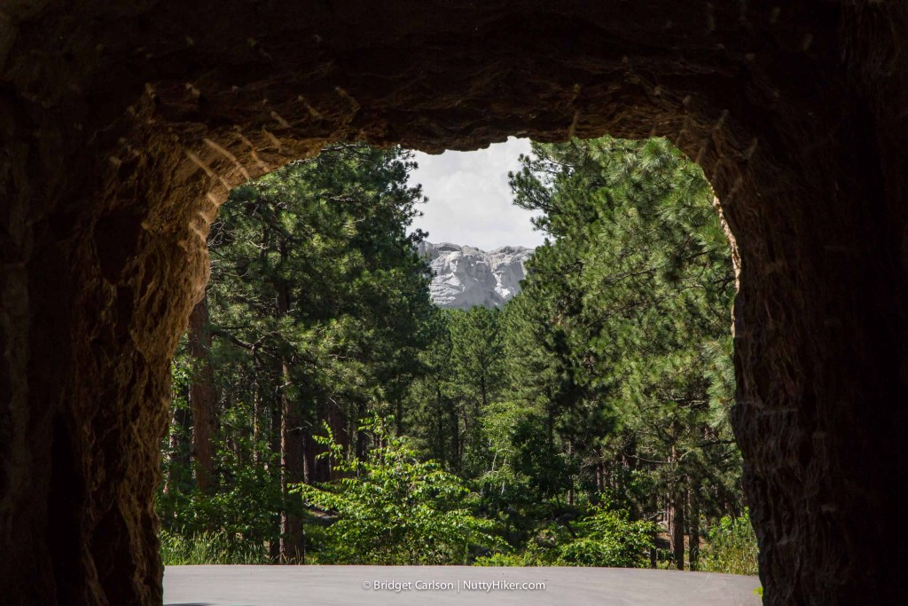 The view of Mount Rushmore Through Mountain Road Tunnel