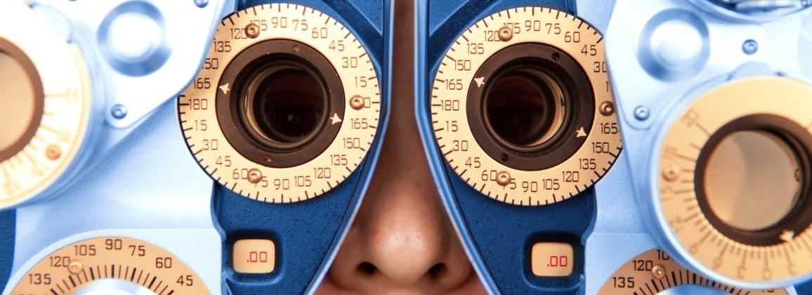Close up horizontal of optometry machine blue and orange