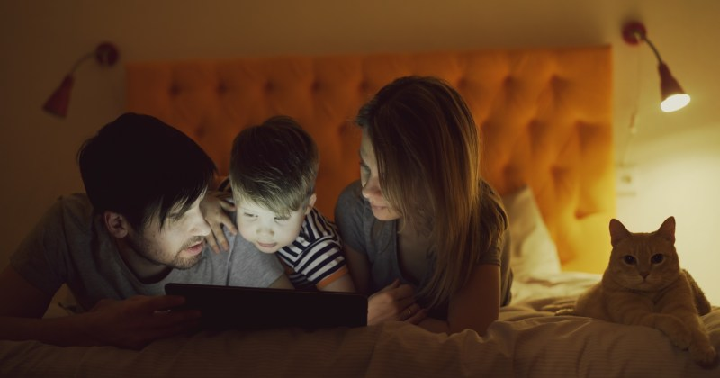 Young family playing on iPad together
