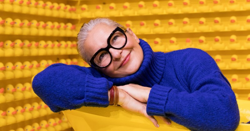 Senior lady with eyeglasses and yellow tub and duckies