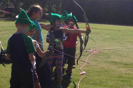Archery students practicing
