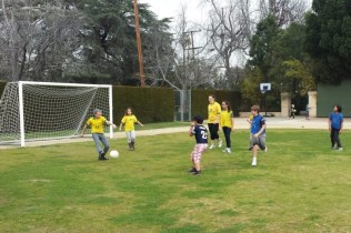 2nd, 5th, and 6th grade playing soccer