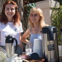 Alumni serving coffee