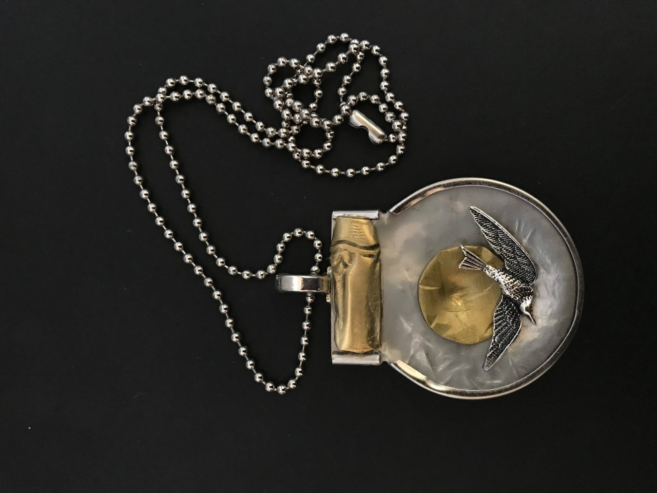 Necklace with bird image