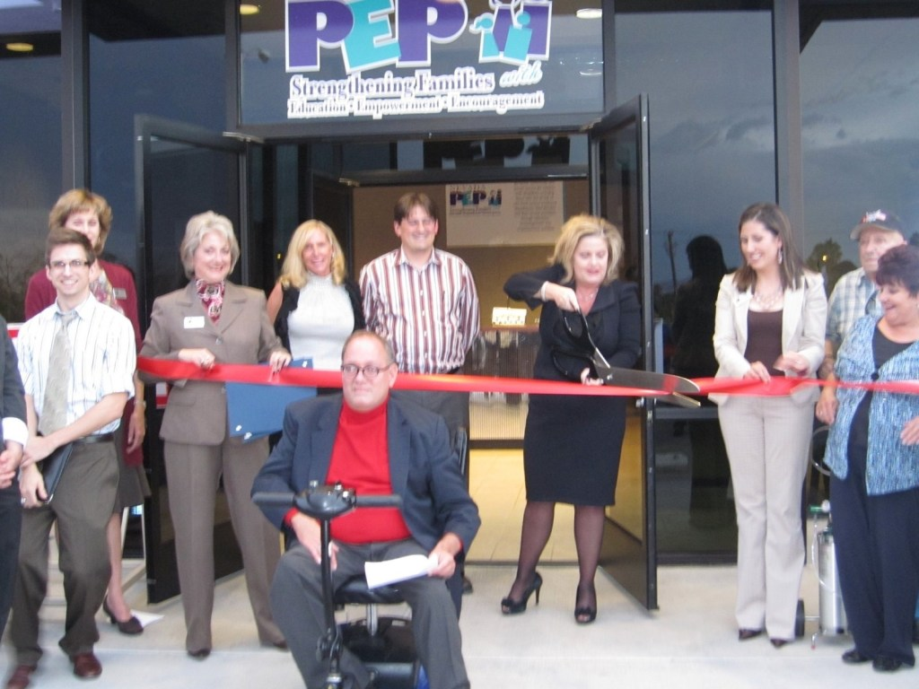Nevada PEP ribbon cutting group photo in front of their new office in 2010