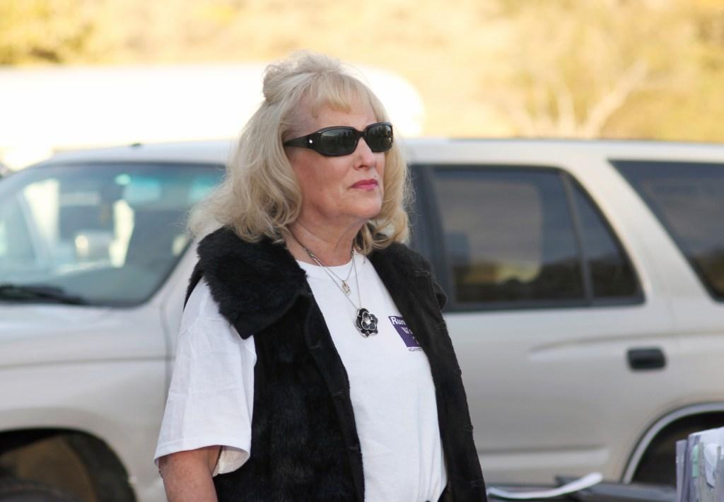 Terri outside with sunglasses