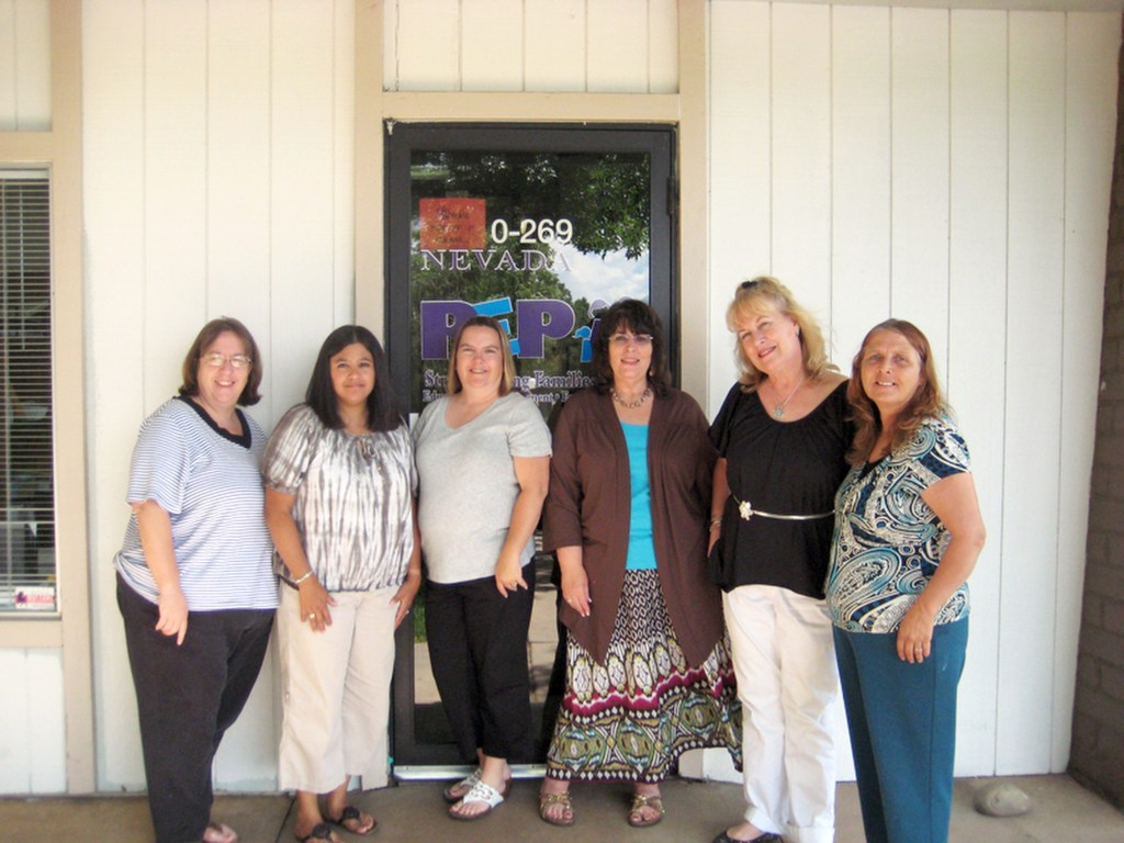 Terri with a group in front of a PEP office