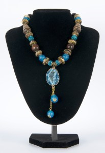 Necklace Light Blue with Round Blue pendant and two blue balls on buste
