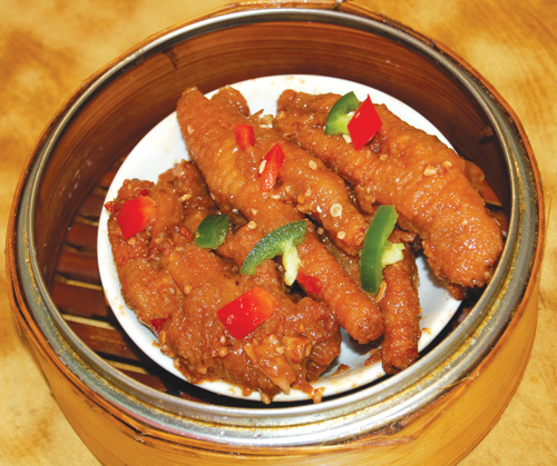 Chicken feet, simmered in a special house sauce, is a popular dim sum dish. Jade Garden Restaurant's chicken feet (above) is particularly known for its succulence.