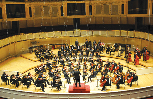 Tsutakawa directed Garfield High School's Symphony Orchestra at the Festival of Gold at Orchestra Hall in Chicago this past spring ( Photo provided by garfieldorchestra.org)