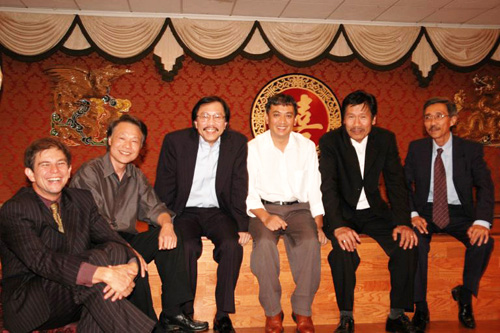 Songwriter Ngo Thuy Mien sits with his Vietnamese friends and colleagues, most of whom are also in the music business.