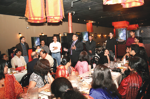 Debudatta Dash, co-chair of the Washington State India Trade Relations Action Committee (WASITRAC), presents filmmaker Prashanta Nanda at a dinner held Oct. 2 at the Spice Route restaurant in Bellevue. The dinner was hosted by Dash and his wife, Itu. (Photo by Vivian Luu/NWAW)
