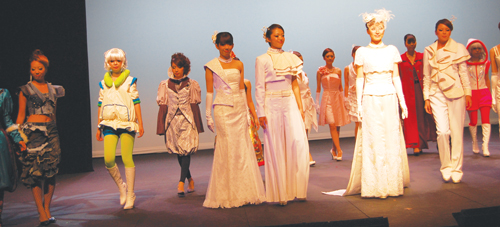 Bunka students create bridal gowns in traditional white. 7. The lights were turned off to feature glow-in-the-dark designs