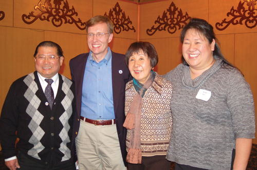 The Sun family, father Lo-Yu (left), mother Shao-Ling (middle-right), and daughter Sandy (right) stand with Attorney General Rob McKenna at a fundraiser they helped to host at China Harbor on Dec. 3. (Photo by Rebecca Ip/NWAW)