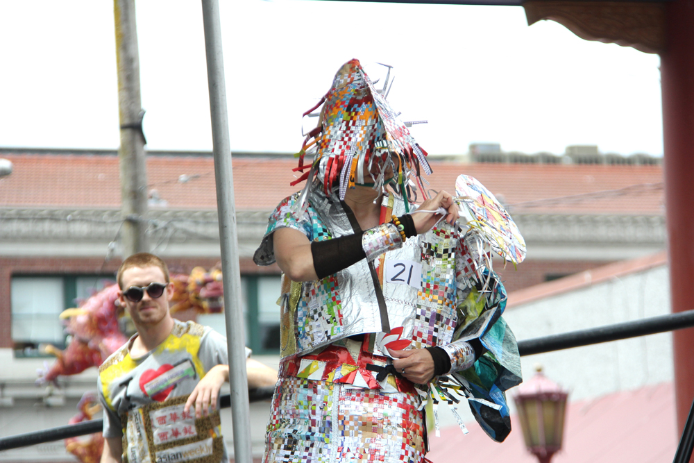 Designed by Vivian Yuri. Kyoto fushion techno two piece outfit made of hand cut and hand woven strips of paper from magazines, bus schedules, onion bags, and coffee bags. The hat is woven strips of coffee bags. (Photo by Eugene Tagawa)